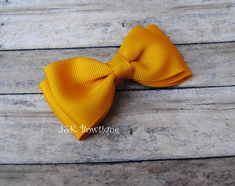 Double layer bow tie bow....Mustard color