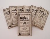 30s vintage NuAce black photo mounting corners...medium size, unopened packet of 100...made in USA by Ace Art Co.