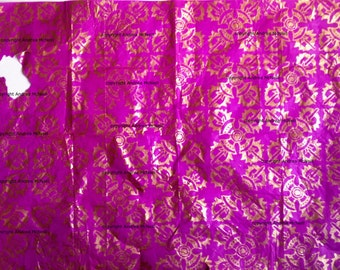 Sheet of pink tissue paper with Asian woodblock in copper