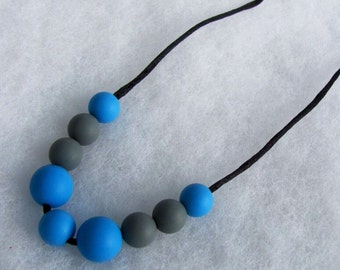 Silicone Teething Necklace. Blue and Gray. Silk cord. Snap safety closure.