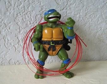Teenage Mutant Ninja Turtle, Talking Leonardo with three talking strips, 1991. Rare