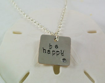"Hand-stamped ""be happy"" necklace"