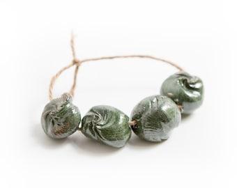 Oceans of unthinking night -- a set of 4 dark ceramic art beads