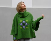 Light green poncho with cowl decorated mandala motif  (with warmers cuffs and a badge)