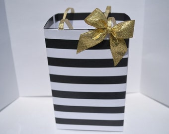 """Black and white stripe with gold bow bag/box, Bag/Box size is 4.25"""" wide by 6"""" tall by 3.5"""" depth (front to back)"""