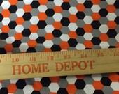 Robert Kaufman orange black white honeycomb on gray cotton Lycra