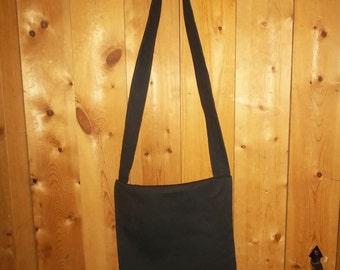 Black haversack of cotton canvas.