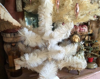 A Vintage White Bottle Brush Christmas Tree Perfect For A Cozy Space