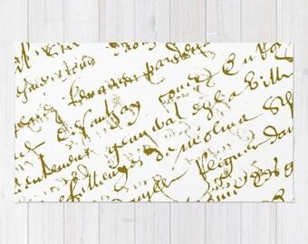 Rug, French Script Gold script on white