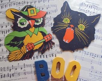 Pair of vintage Halloween die cuts repurposed with magnets