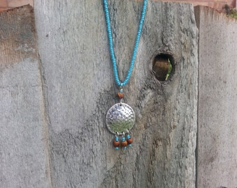 Navajo pendant necklace with Ghost beads and turquoise seed beads.
