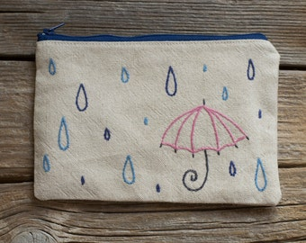 Zipper Pouch with Raindrops and a Pink Umbrella, Hand Embroidered Rain Cosmetic Bag