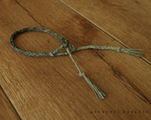 Braided bracelet linen thread hand dyed  bohemian tassel bracelet rustic and minimal. nuance of blue