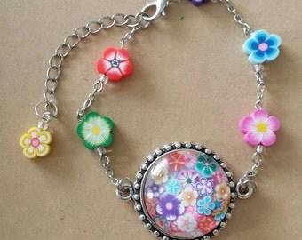 Sale was 16 now 14uk Multicoloured Faux Milli Fiori Large Cabachon bracelet and flowers.