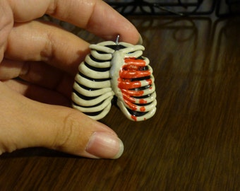 Bleeding heart ribcage pendant