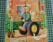 John Deere teddy bear on tractor fabric panel
