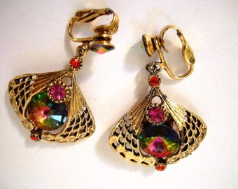 EARCLIPS about 1950, 1 3/4 inch long,Varied colored rhinestones (aurora borialis colors -pinks & greens)in goldtone metal