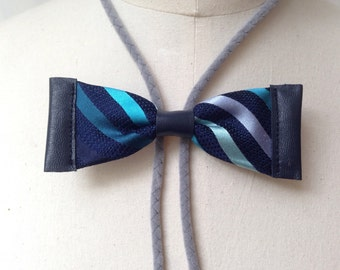 Striped blue silk bow tie with blue leather and grey bolo cord (B22)