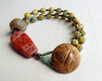 Scarab - handmade artisan bead bohemian bracelet w rustic bronze scarab in earthy turquoise + red tones  - Songbead UK, narrative jewellery