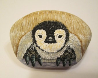 Baby Penguin hand painted on a rock by Ann Kelly