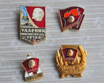 Set of 4 Vintage Soviet aluminum badges.