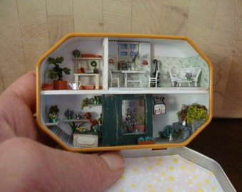 dollhouse miniature in a box of candies