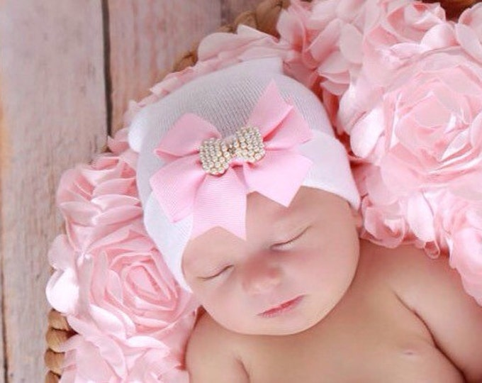 Featured listing image: White Newborn Hospital Hat with a Pink Grosgrain Bow Adorned with a Pearl Bow Button, baby hat, Lil Miss Sweet Pea Boutique
