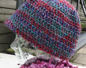 Crochet beanie hat in variegated blue and purple yarn