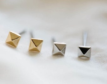 SPIKE >> tiny silver pyramid spike studs << goes with everything cuz they are awesome.  just like you