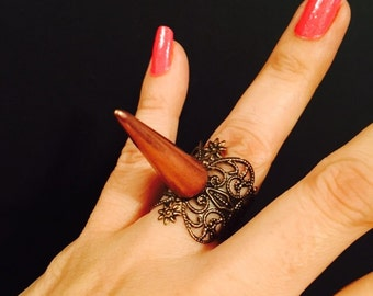 Single spike filigree ring made in antique copper color metal,with a spike on top, The ring is sizable.