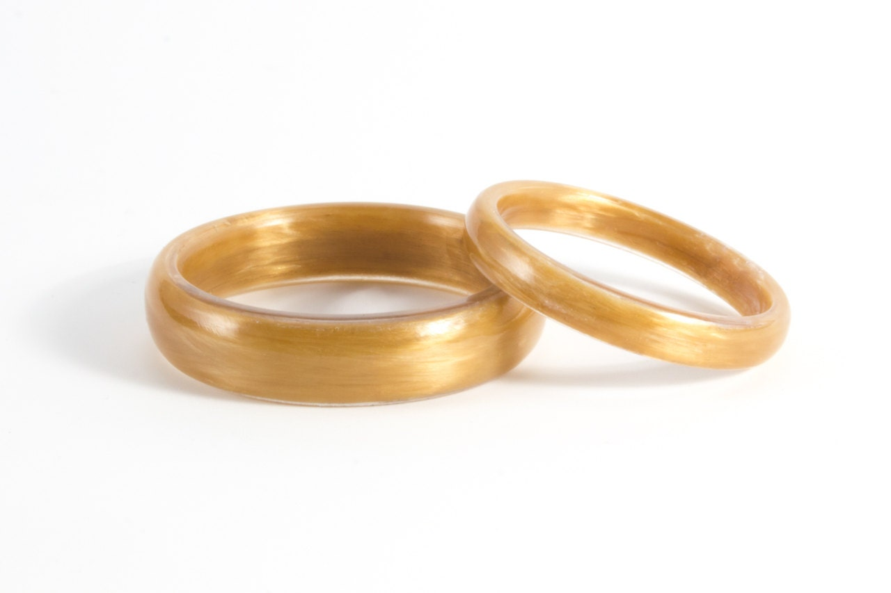 Set of two kevlar wedding bands unique and industrial golden for Kevlar wedding ring