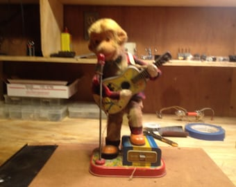 1950s Alps, Rock n Roll Monkey,, Battery operated monkey plays guitar and rocks out, classic 50s toy,.