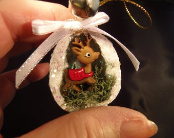 Christmas ornament miniature REINDEER in a walnut half shell jingle bell rings in Christmas glitter and moss very unique ornament