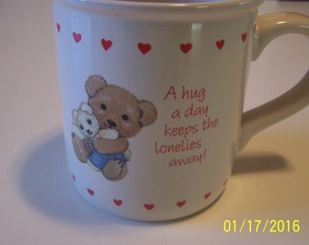 """American Greetings Cup """" A Hug a Day Keeps the Lonelies Away """""""