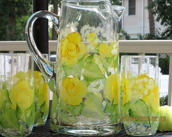 Pitcher four matching Glasses, hand painted with yellow Roses, green leaves,  white Baby breath throughout the whole set. ingeborgsorgent