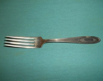 "One (1), Silver Plated, 7 3/8"" Dinner Fork, from S.E.B./National, in the SEB Four Pattern."