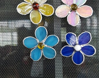 Stained glass flower screen hangers.