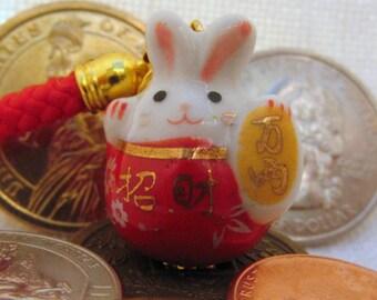 Maneki Neko Lucky Rabbit Porcelain Phone/Handbag Charm with Red Braided Strap/Lanyard and Bell.  RED .