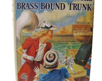 "vintage Nancy Drew book, titled, ""Mystery of Brass Bound Trunk""  from the 1950's."