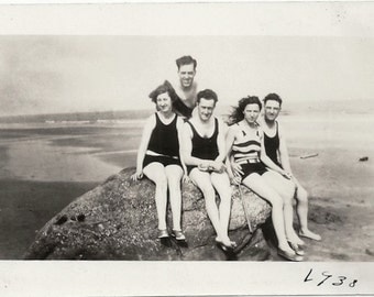 Old Photo Group of Women and Men wearing Swimsuits sitting on Rock at the Beach 1930s Photograph snapshot vintage