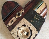 Wood heart designed with antique blocks, trim, bead board