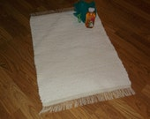 Hand woven bath mat or small rug made entirely of a vintage hobnail bedspread fabric.