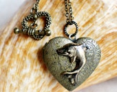 Dolphin heart photo locket, heart shaped bronze locket with dolphin on front cover.