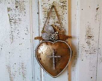 Ornate heart wall hanging gold painted metal embellished rhinestone French Santos locket style embellishment home decor anita spero design