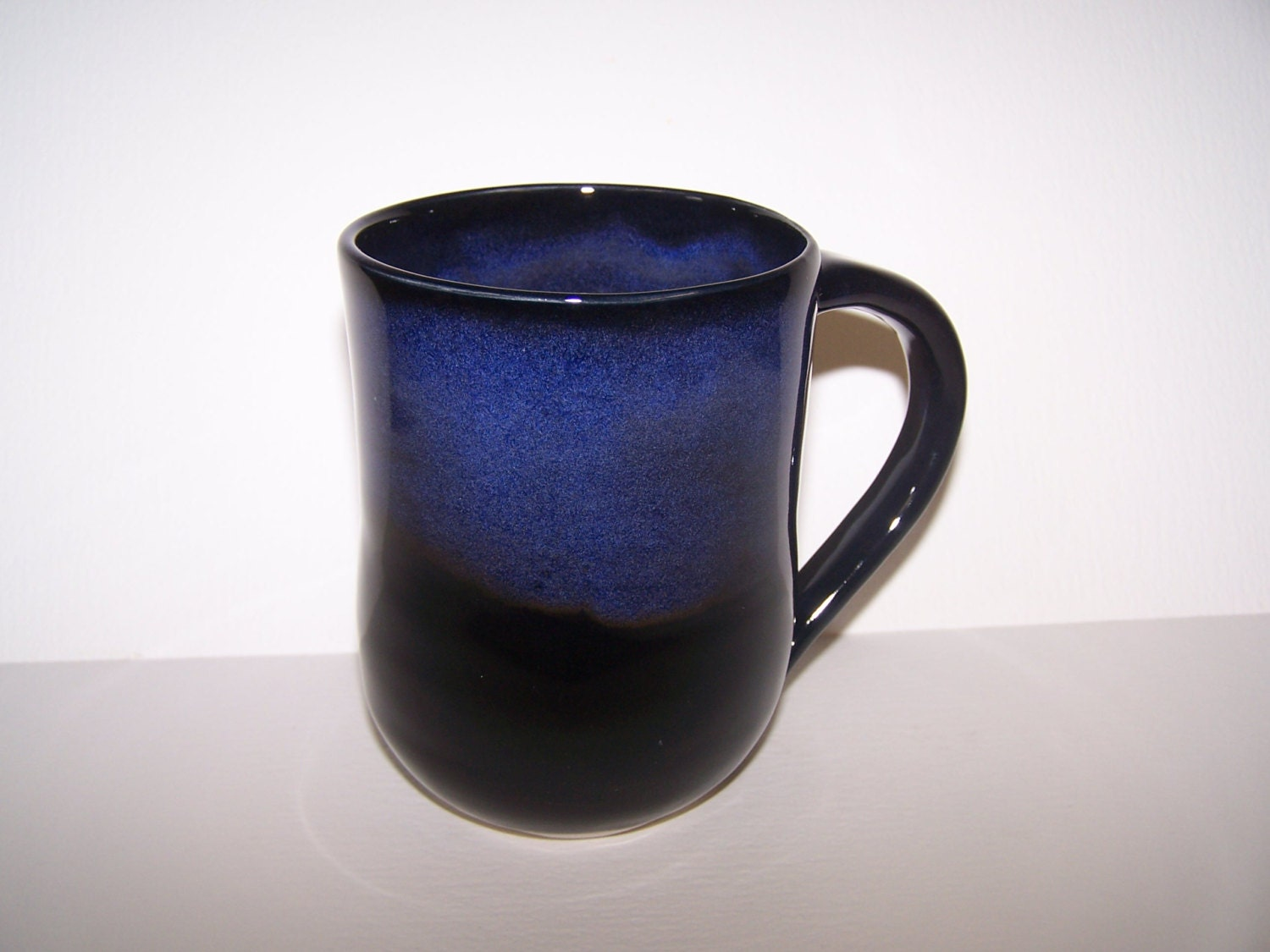 Stoneware Handmade Pottery Mug Glazed In Black With Blue
