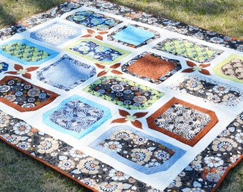 "Moonstruck Galleria, Blue, Brown and Green Throw Quilt 63""x 74"". Flannel Backed with Detail Quilting."