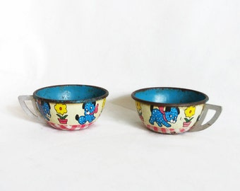 Ohio Art, vintage tin toy tea cups. Cute puppies. Two pieces. Old tinplate lithography. Polka dotted blue puppy. Pretend play, much enjoyed
