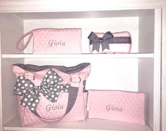 Light pink quilted diaper bag with outside pockets & Grey With White Polka Dots Bow. Add on the matching accessories. Personalized free.