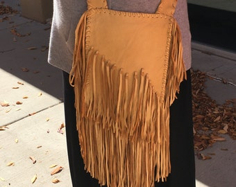 Fringed gold deerskin purse hand laced