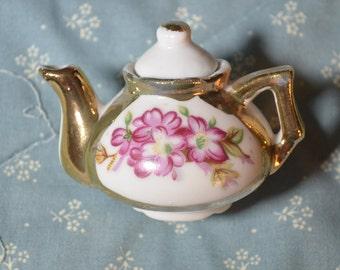 A Vintage Little Miniature Teapot with Flowers